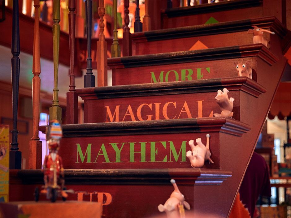 A zoomed-in look of the staircase at Weasleys' Wizard Wheezes: More magical mayhem awaits!