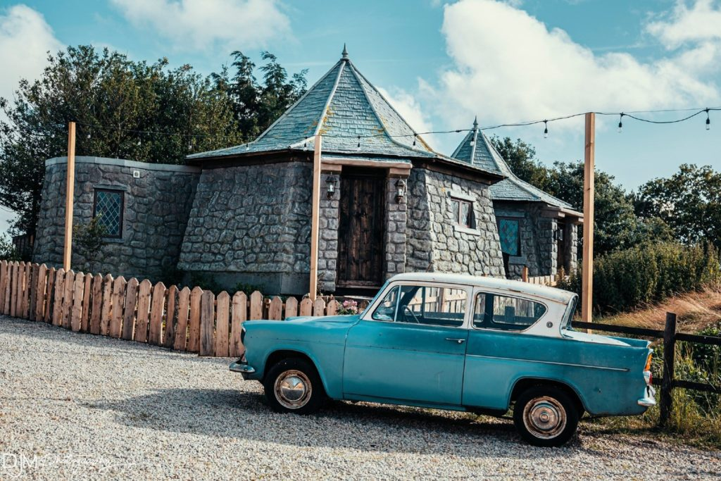North Shire's Groundskeepers Cottage that looks a lot like Hagrid's Hut. There's a battered, blue Ford Anglia parked outside it.