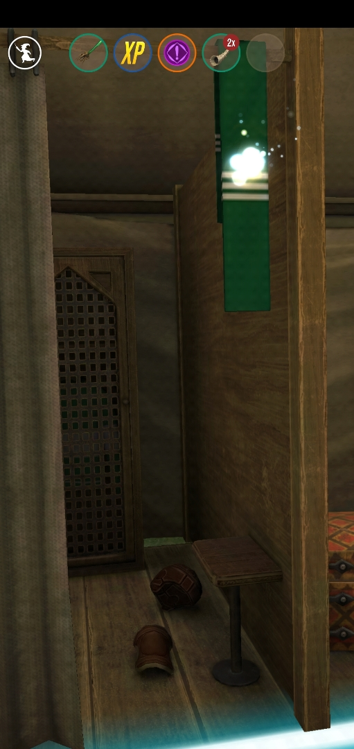 """A Slytherin House scarf hangs in the doorway of a dressing room in the """"Wizards Unite"""" Quidditch Locker Room."""