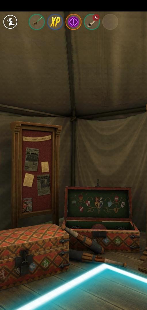 "Quidditch equipment sits in a corner of the Quidditch Locker Room in ""Wizards Unite""."