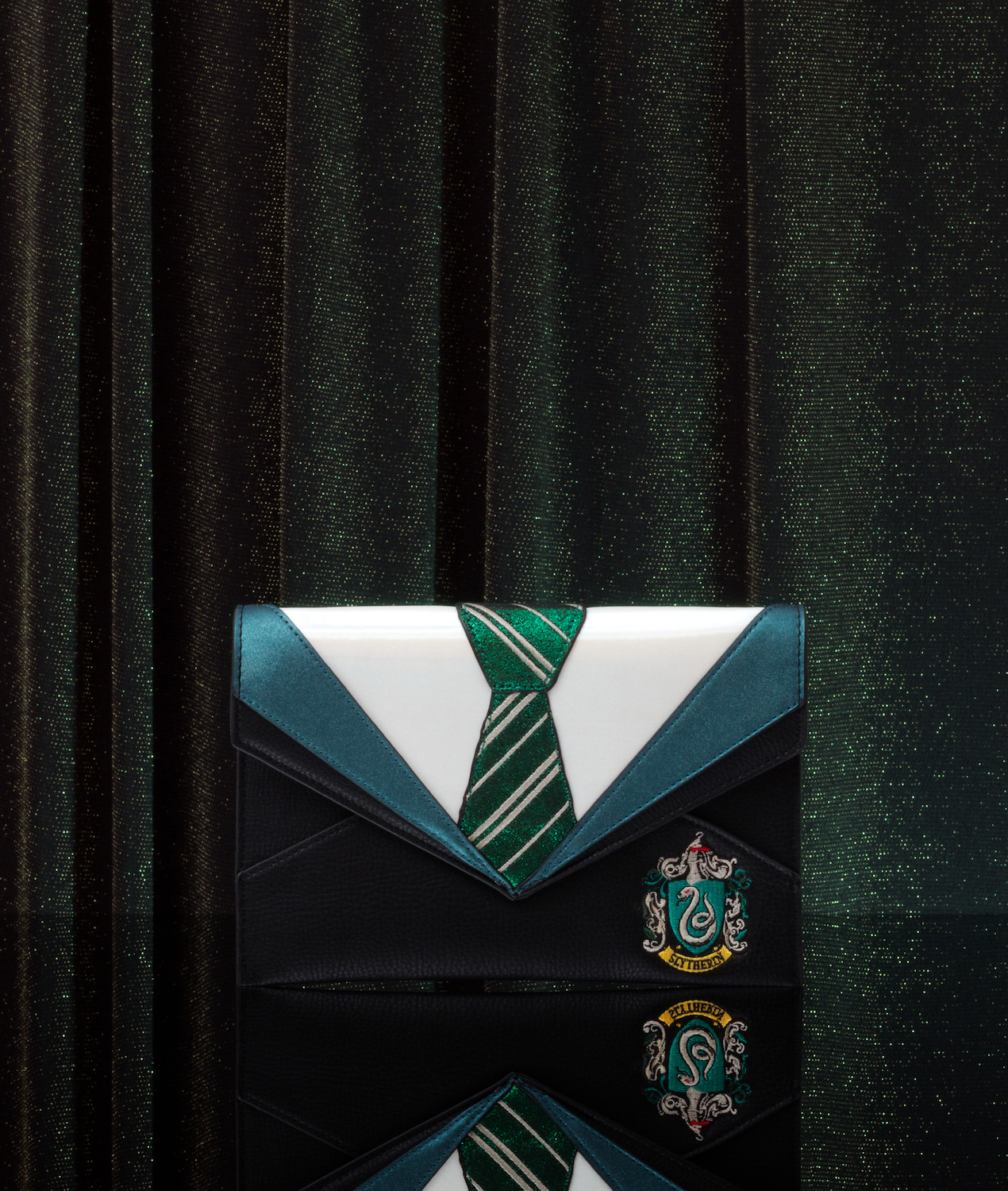 The Danielle Nicole Slytherin Uniform Clutch is for the cunning and ambitious.