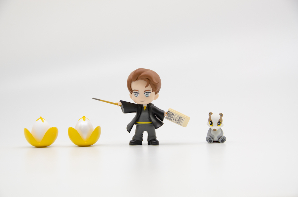 Celebrating his participation in the Triwizard Tournament, the Cedric figure comes with a golden egg.