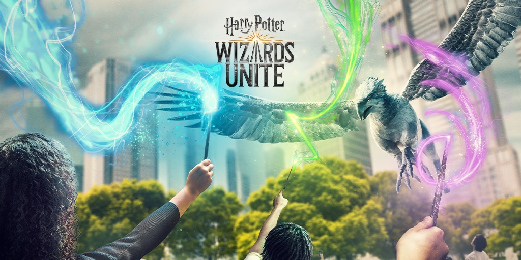 """Characters in """"Harry Potter: Wizards Unite"""" lift their wands skyward."""