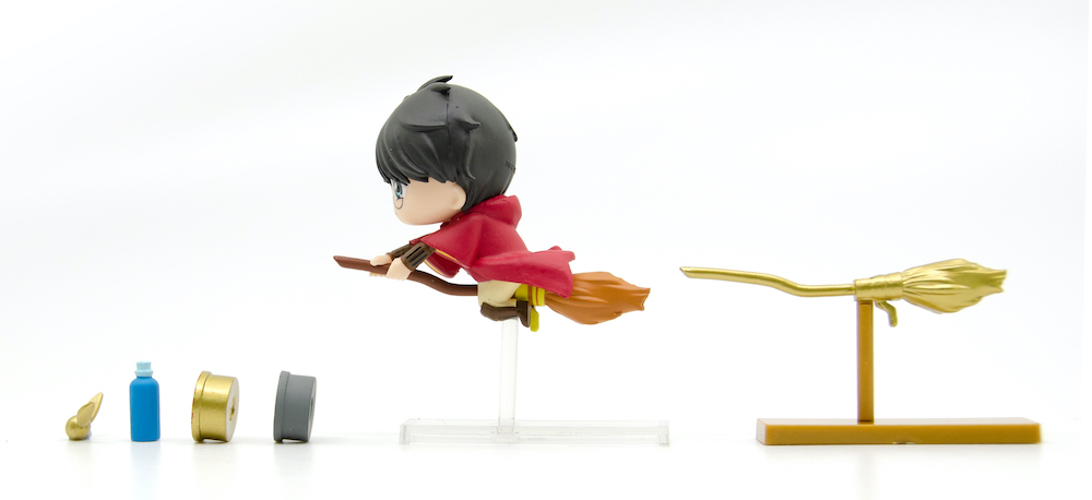 Just in case there is a Whomping Willow about, Quidditch Harry comes with a second broomstick.
