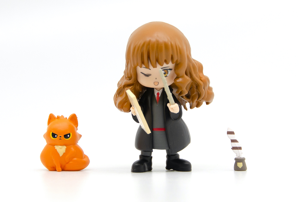 Hermione comes with her trusted feline companion, Crookshanks.