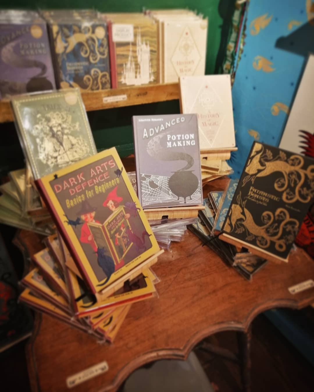 You can get a good look at all the Hogwarts textbooks in real life in MinaLima's gallery.