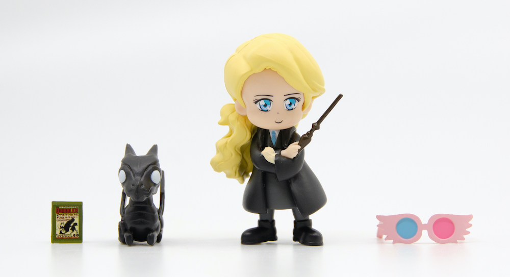 """Luna comes with a copy of """"The Quibbler"""" and her iconic Spectrespecs."""