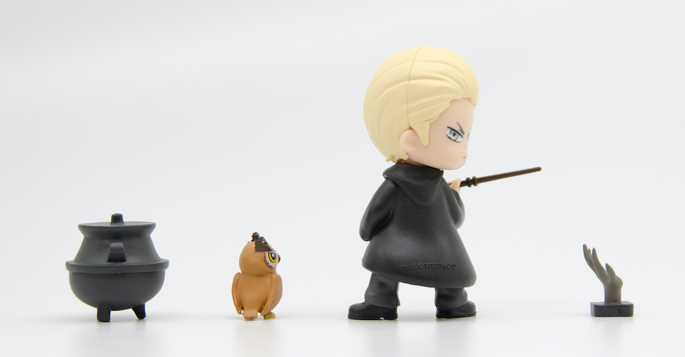 Draco's character figure is posed so that he is looking over his shoulder.