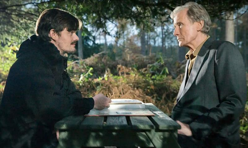 Bill Nighy and Sam Riley face each other across a table as father and son in Sometimes Always Never.