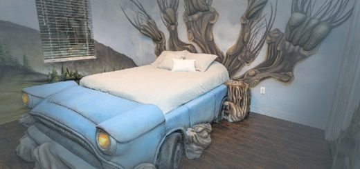 A custom bed in the shape of Arthur Weasley's pale blue Ford Anglia car is pictured in the middle of a bedroom. At the head of the bed, the Whomping Willow is painted on the wall very elaborately, with three dimensional elements protruding from the wall. The Hogwarts grounds are painted on the rest of the walls.