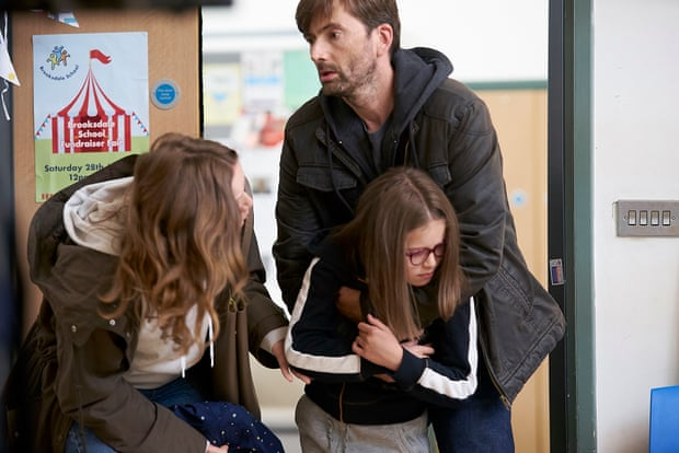 David Tennant and Jessica Hynes act struggling parents of a child with learning disabilities. They are pictured in character, bringing Rosie, their eleven year old daughter to school.