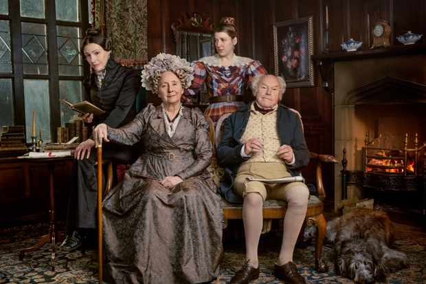 The Lister family in Gentleman Jack is sitting by the fireplace in Shibden Hall. Anne Lister, Aunt Anne, Marian, and Captain Lister pose in character.