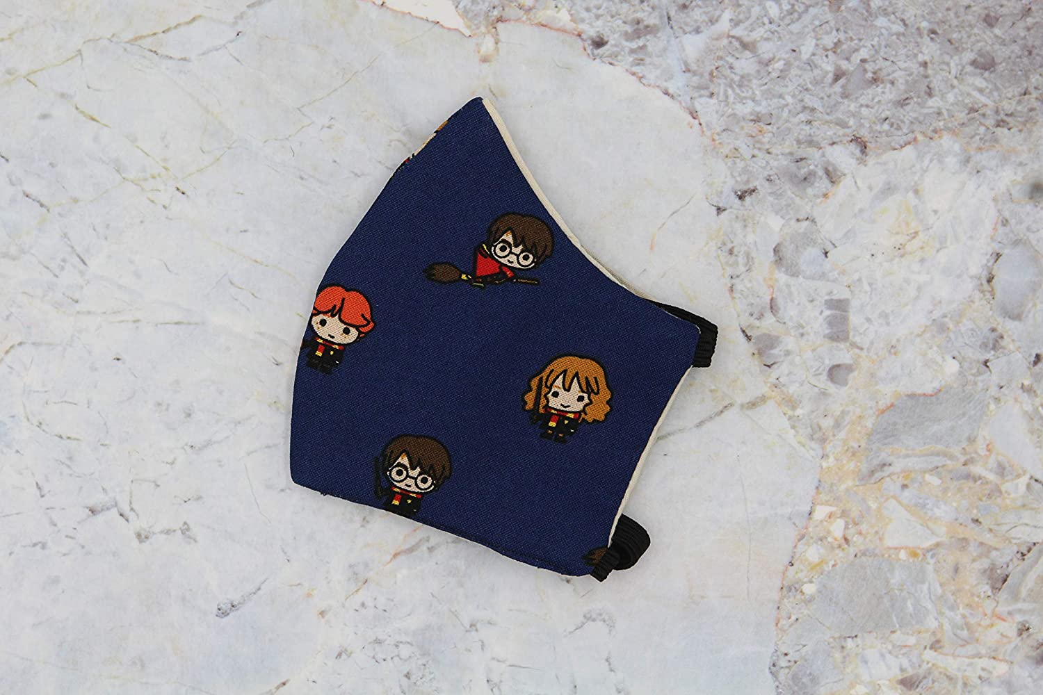 face mask with chibi Harry, Ron, and Hermione print on navy material