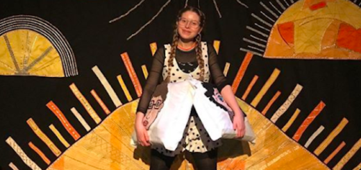 Jessie Cave poses with some tote bags as part of her live show.