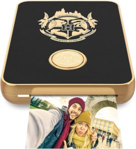 A hand-held photo printer with the Hogwarts crest on it.