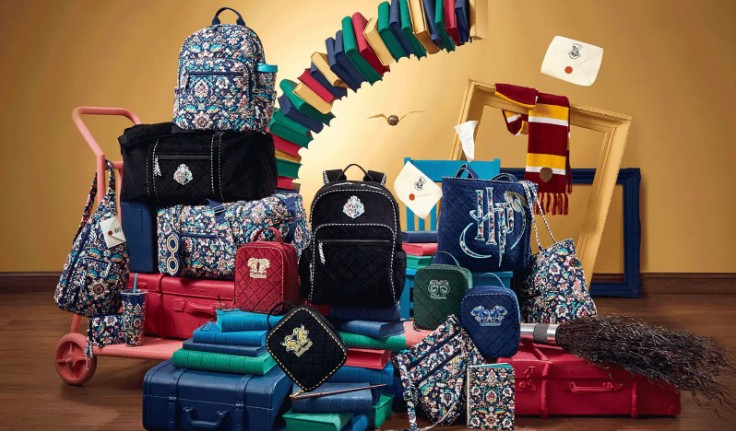 Various bags, handbags, lunchbags, wallets are pictured in Hogwarts themed designs among floating Harry Potter items such as books, acceptence letters, scarves, and the golden Snitch.