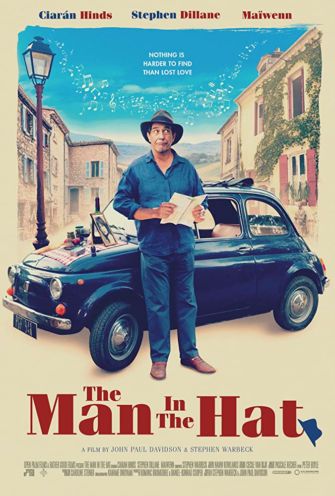 "Pictured is a movie poster for ""The Man in the Hat"", starring Ciarán Hinds."