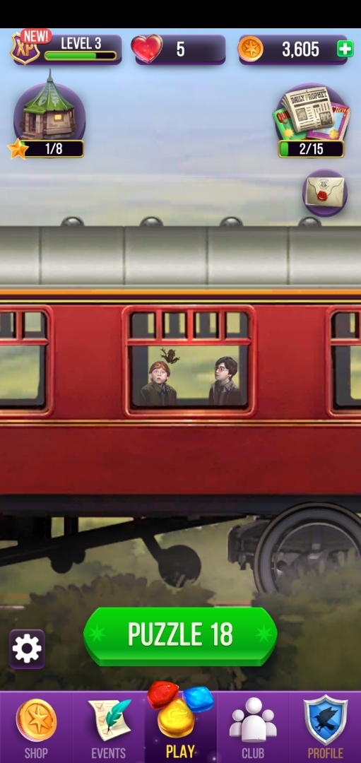 Harry Potter and Ron Weasley watch as Harry's Chocolate Frog makes its escape aboard the Hogwarts Express.