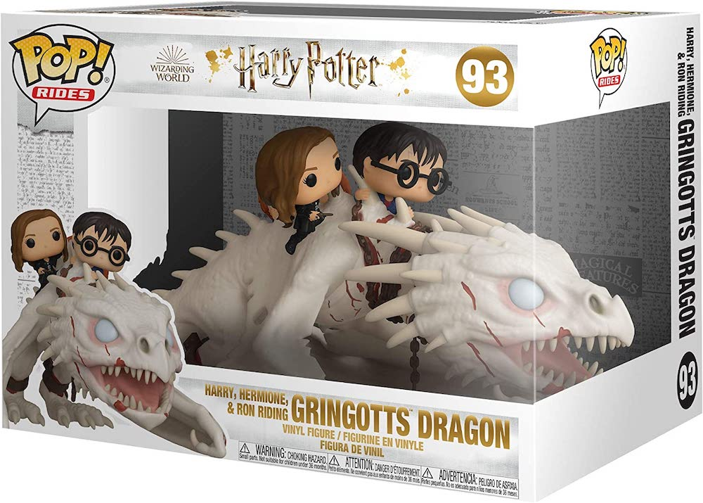 An image of the packaging for the Funko Pop! of Harry, Hermione, and Ron riding the Gringotts dragon.