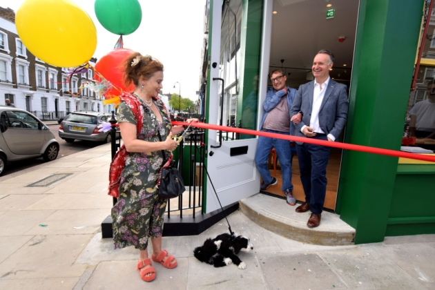Helena Bonham Carter cuts the ribbon at the grand opening of Sam's Cafe in Primrose Hill.