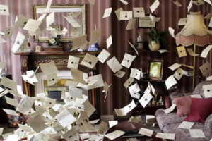 Harry's Hogwarts letters come flying out of the fireplace and fill the room