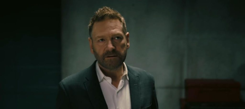 """Sir Kenneth Branagh doesn't look too evil in this film still from """"Tenet"""", but apparently, he still is."""