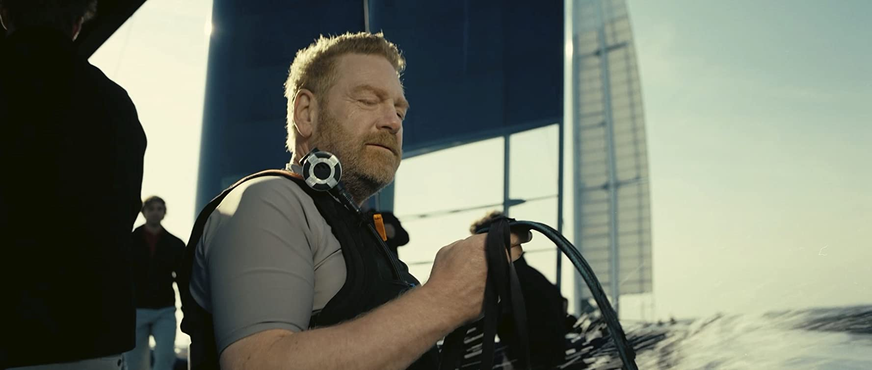 "Sir Kenneth Branagh prepares his villainous supplies in this film still from ""Tenet""."