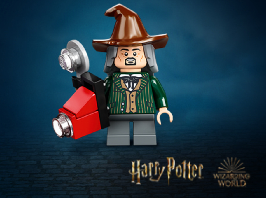 "A product image of the ""Daily Prophet"" photographer, Bozo, in LEGO minifigure form."