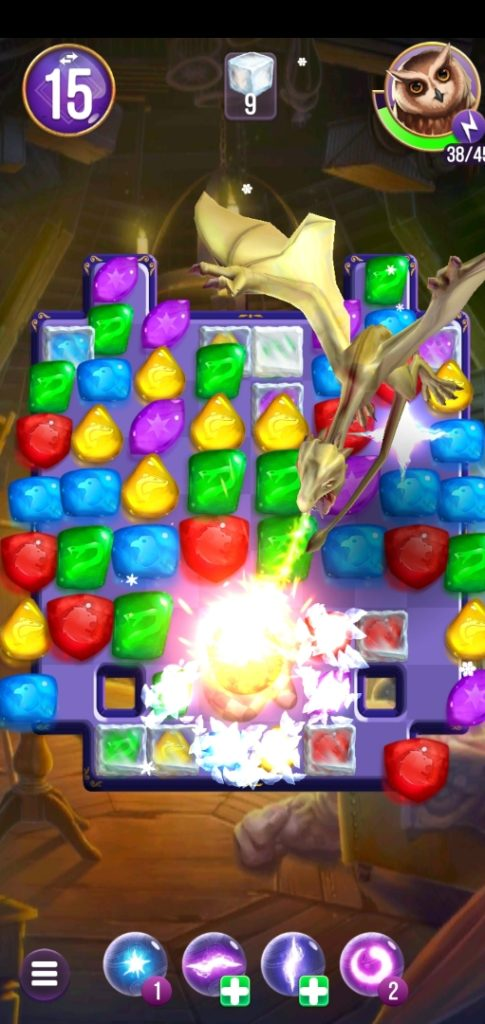 """A baby dragon scorches the board in """"Puzzles & Spells""""."""