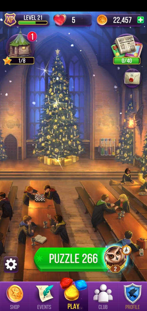 """The Great Hall is bedecked in Christmas finery in """"Puzzles & Spells""""."""
