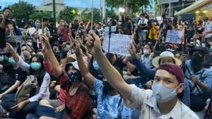 Protestors raise wands at Harry Potter protest.