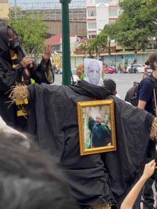 A scarecrow with Voldemort's picture is pictured.