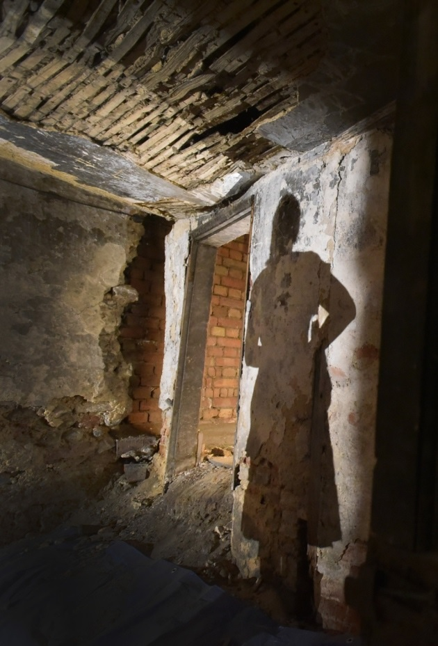 Guests wander around the interior of what was once a home in Norwich's hidden street.