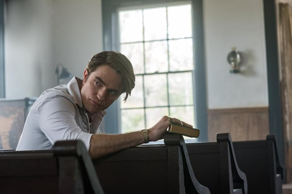 "Robert Pattinson is losing his religion in ""The Devil All the Time""."