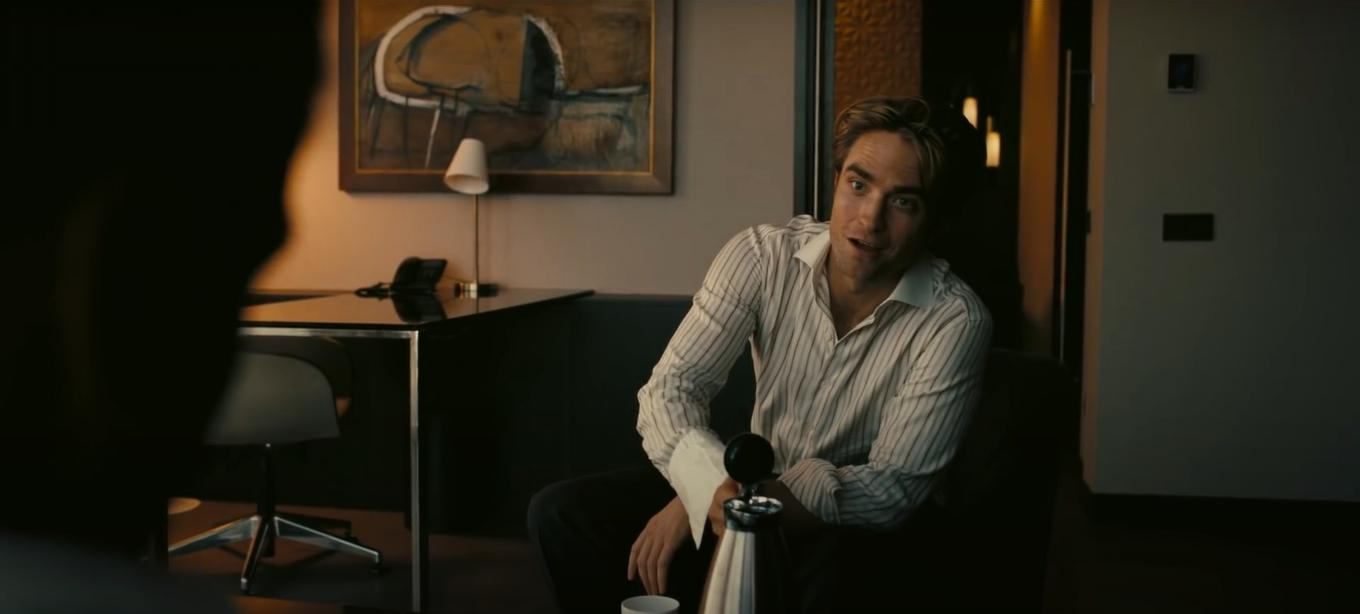 "Robert Pattinson powers up with a little caffeine in this film still from ""Tenet""."