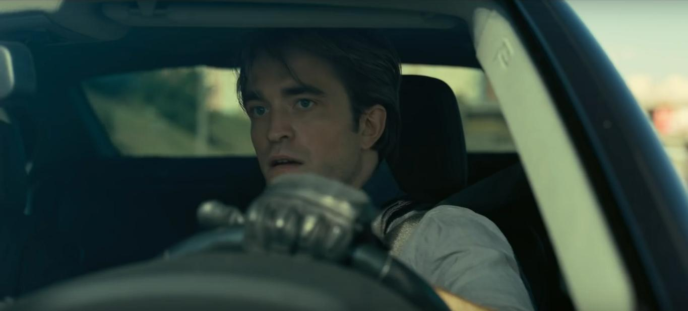 "Robert Pattinson puts his driving skills to the test in this film still from ""Tenet""."