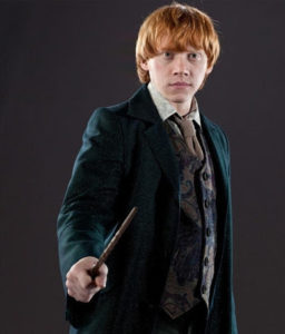 Ron wearing a suit and holding a wand