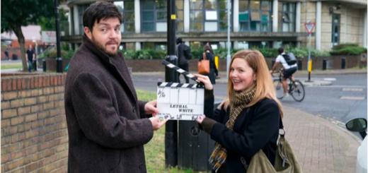 """Tom Burke (Cormoran Strike) and Holliday Grainger (Robin Ellacott) filming for """"Strike: Lethal White""""."""