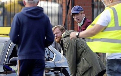 """Domhnall Gleeson and brother Brian are pictured on the set of """"Frank of Ireland""""."""