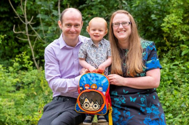 Dr Chris Hand and Dr Joanne Ingram with their son Eric, who is holding a harry potter backpack.