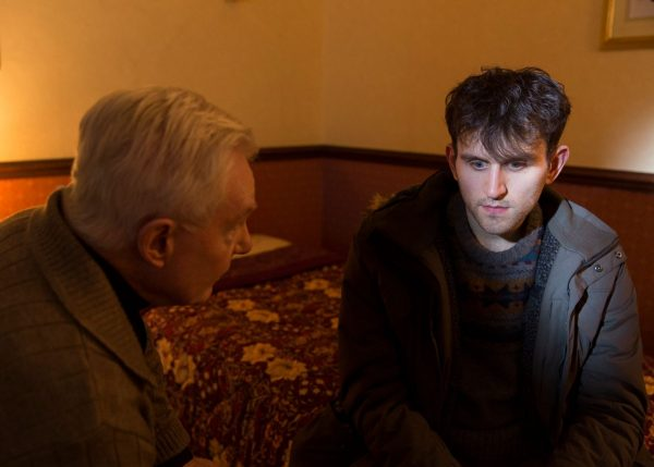 """Harry Melling listens to Derek Jacobi in a film still from """"Say Your Prayers""""."""