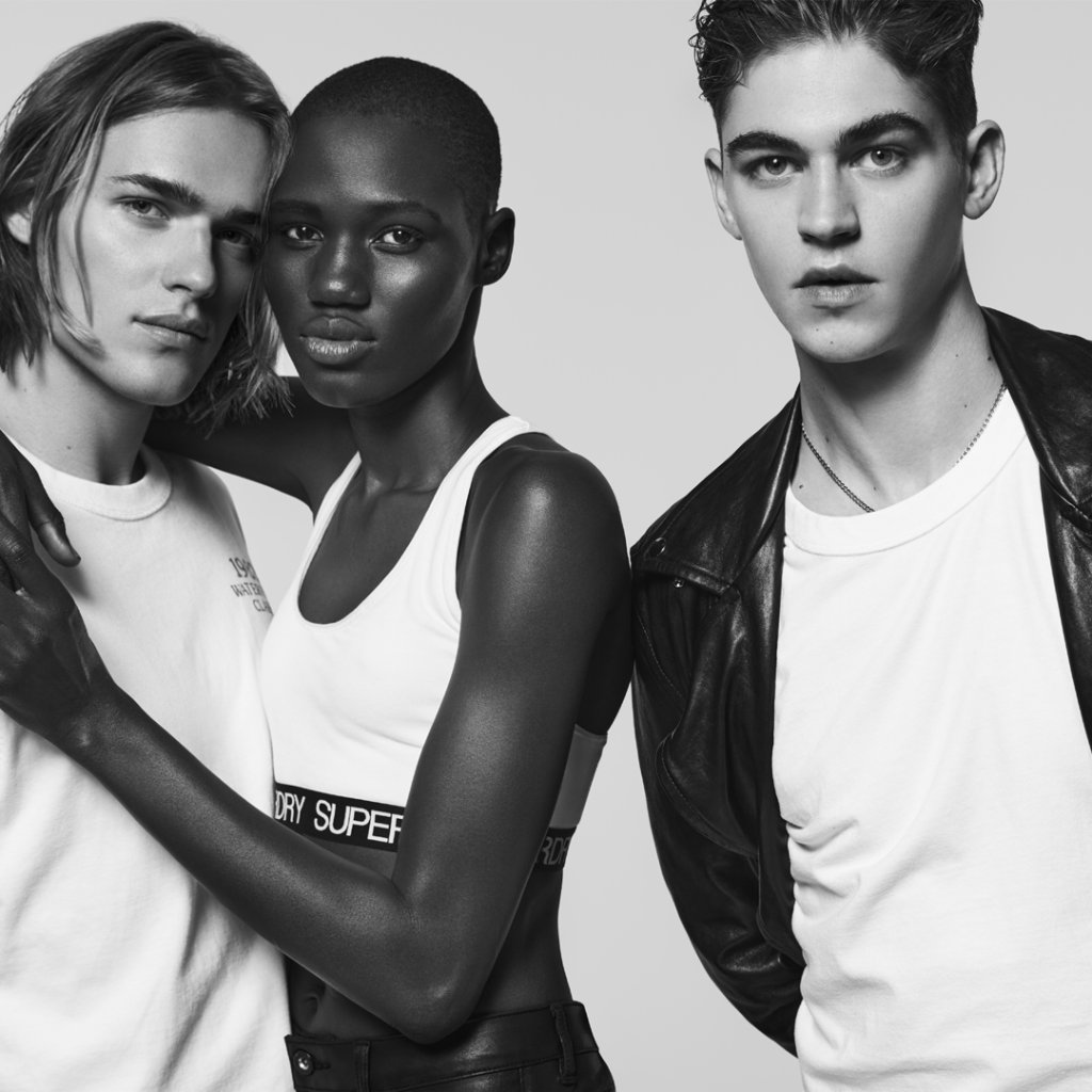 Hero Fiennes-Tiffin photobombs his friends but in a really brooding way.