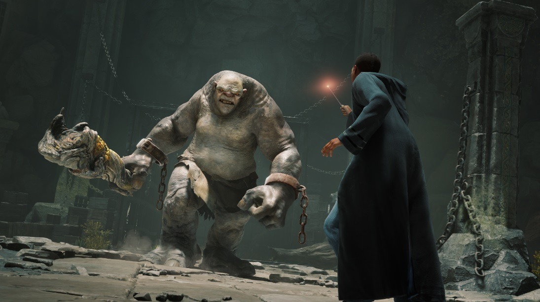 """A screenshot from """"Hogwarts Legacy"""" shows a character taking on a troll."""