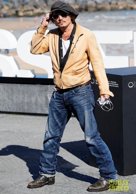 Johnny Depp poses cheekily for a photo at the San Sebastian Film Festival.