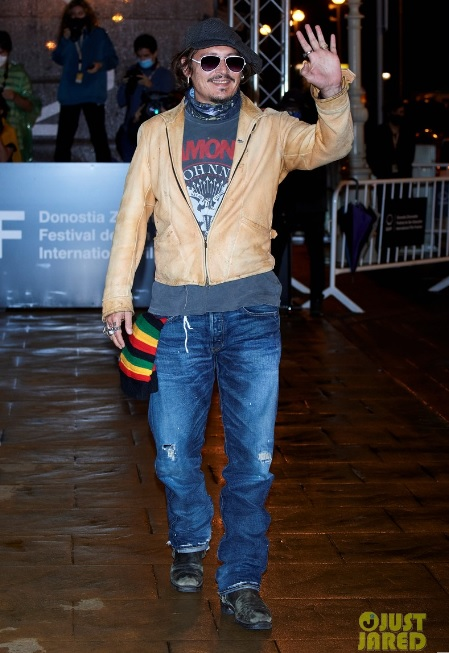 Johnny Depp waves to the crowd as he arrives for the San Sebastian Film Festival.