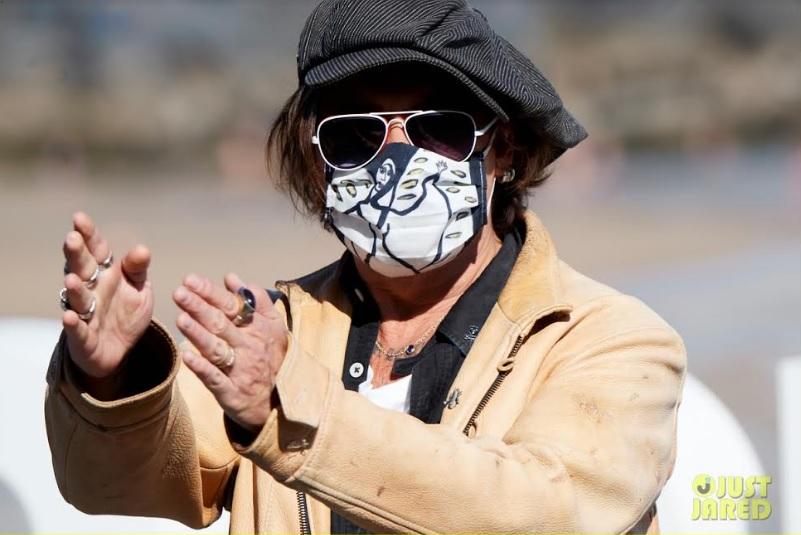 Johnny Depp masks up at the San Sebastian Film Festival.