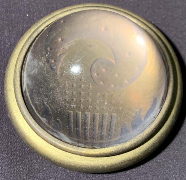 """One of the """"Fantastic Beasts"""" items up for sale is this MACUSA paperweight."""