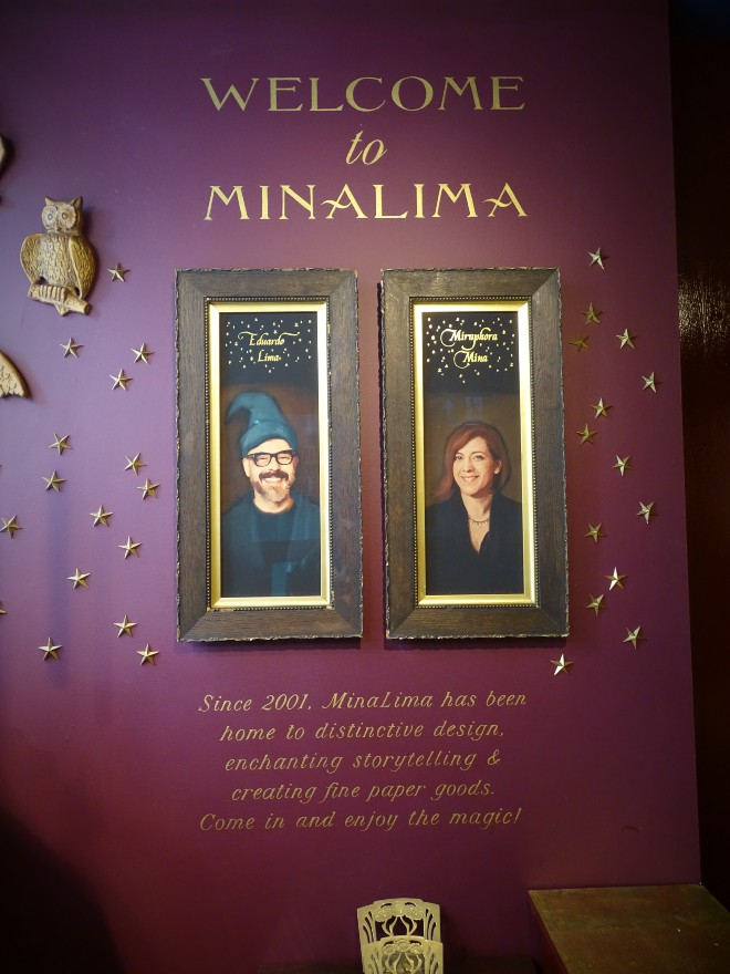 There is a welcome to MinaLima sign in the shop area with Mira and Eduardo's portraits.