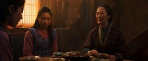 Hua Li and Mulan sitting at a table