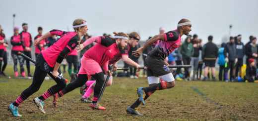 There are four running players in pink jerseys,
